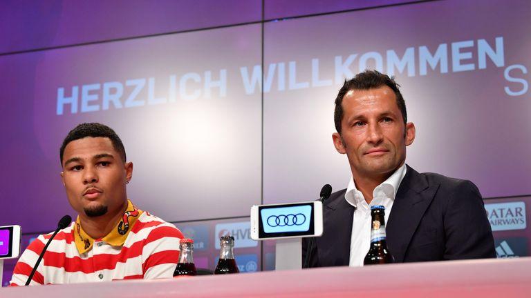Gnabry sat with Bayern's sports manager Hasan Salihamidzic at his unveiling