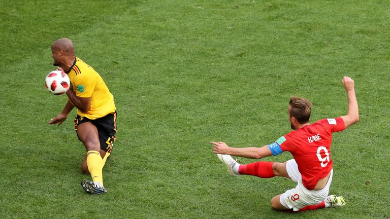 Harry Kane drags a shot wide under pressure from Vincent Kompany