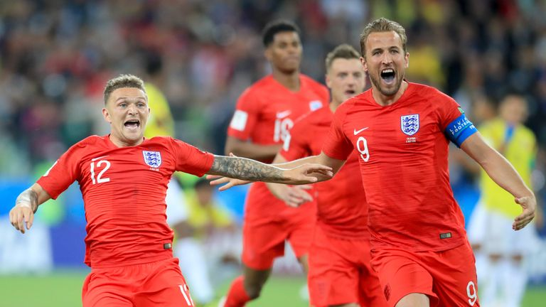England's players celebrate winning the penalty shootout against Colombia