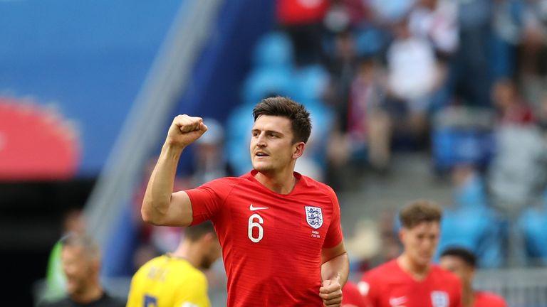 Harry Maguire celebrates scoring against Sweden