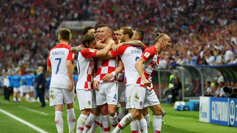 Goalscorer Ivan Perisic celebrates with teammates after equalising for Croatia