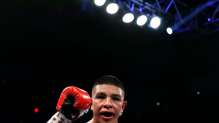 WBO junior middleweight champion Jaime Munguia of Mexico celebrates his unanimous decision victory over Liam Smith of England in Las Vegas