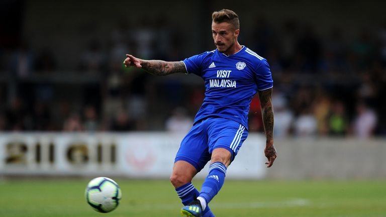 Joe Bennett dons Cardiff's new home kit against Torquay in pre-season
