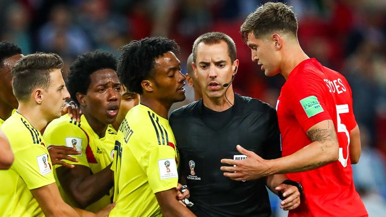 John Stones and Juan Cuadrado have to be separated by referee Mark Geiger during England's last-16 match against Colombia