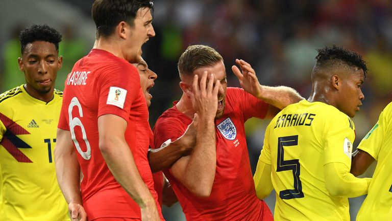 Jordan Henderson goes down after an apparent headbutt from Wilmar Barrios