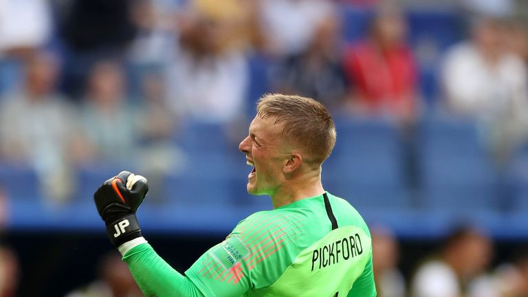 Jordan Pickford celebrates England's opening goal against Sweden