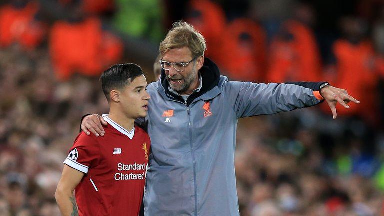Liverpool's Philippe Coutinho prepares to be subbed on by Liverpool manager Jurgen Klopp during the UEFA Champions League, Group E match v Sevilla at Anfield, Liverpool, 13 September 2017