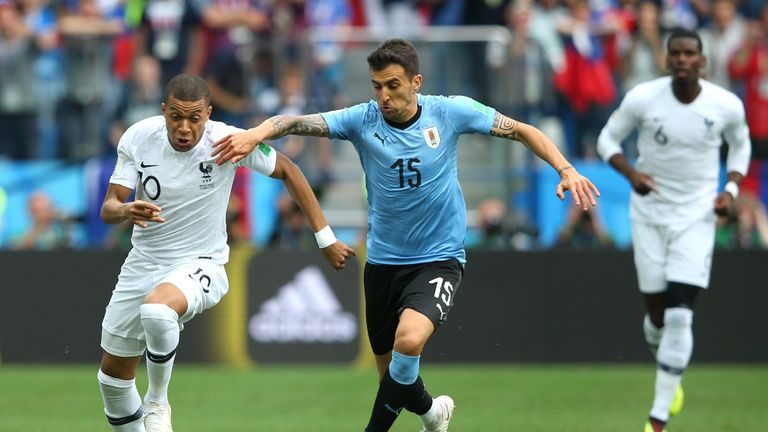 Kylian Mbappe and Matias Vecino in action during the 2018 FIFA World Cup quarter final between Uruguay and France