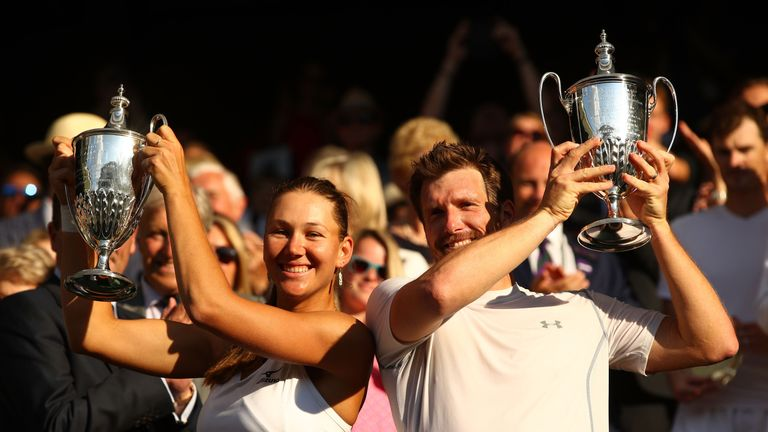 Nicole Melichar and Alexander Peya celebrate with their mixed doubles trophies
