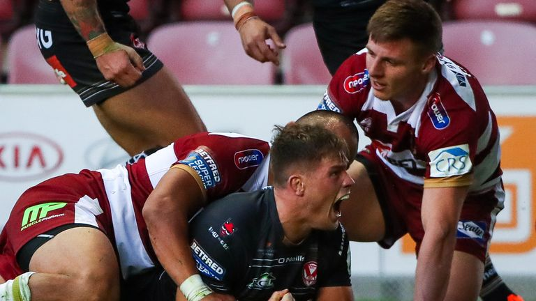St Helens' Morgan Knowles celebrates his try.