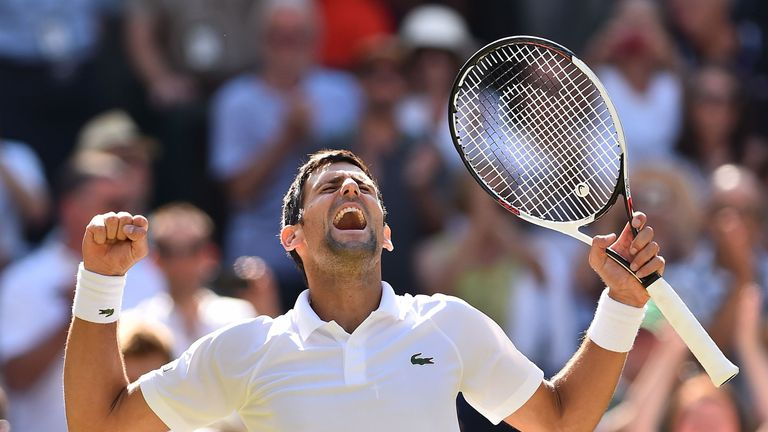 Serbia's Novak Djokovic celebrates after beating South Africa's Kevin Anderson 6-2, 6-2, 7-6 in their men's singles final match on the thirteenth day of the 2018 Wimbledon Championships at The All England Lawn Tennis Club in Wimbledon, southwest London, on July 15, 2018.