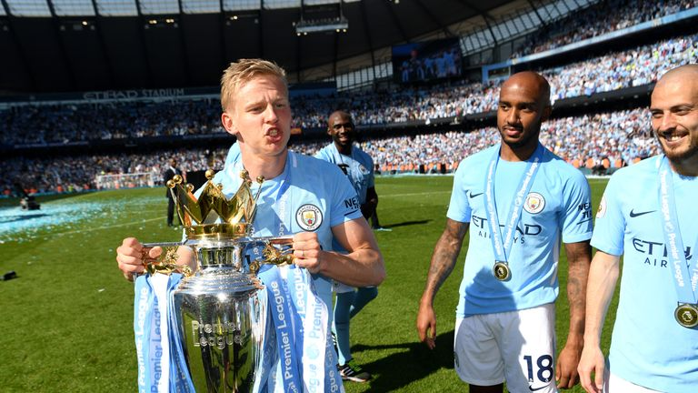Oleksandr Zinchenko celebrates with the Premier League trophy after the match between Manchester City and Huddersfield Town at Etihad Stadium on May 6, 2018