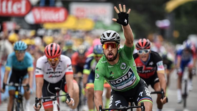 Peter Sagan celebrates as he crosses the line on stage 13