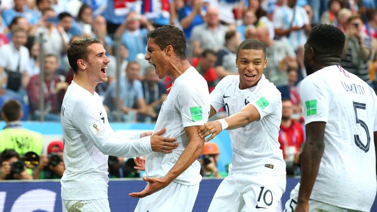 Raphael Varane celebrates his goal with team-mates Kylian Mbappe and Antoine Griezmann