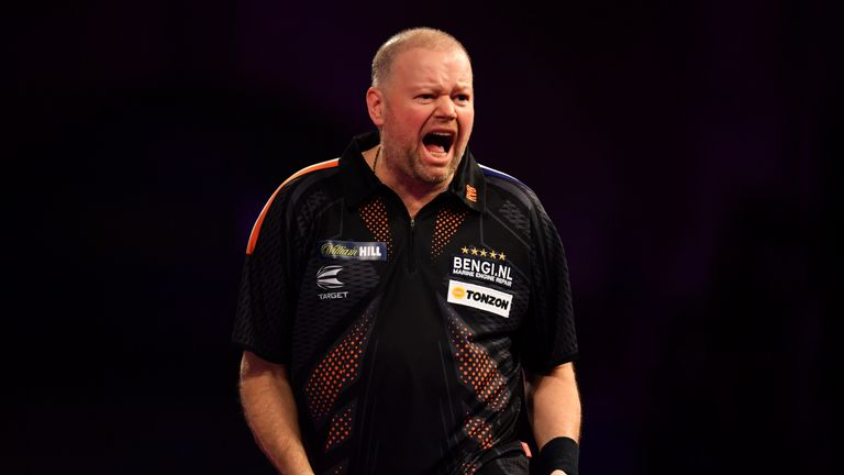 Raymond Van Barneveld celebrates during his Quarter Final Match against Michael Van Gerwen during the 2018 William Hill PDC World Darts Championships on Day Thirteen at Alexandra Palace on December 29, 2017 in London, England