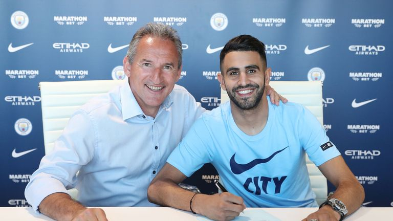 Riyad Mahrez has signed a five-year contract with Manchester City for a club-record £60m