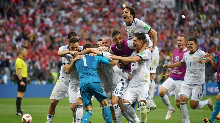 Russia players celebrate after beating Spain on penalties in the last 16 of the World Cup