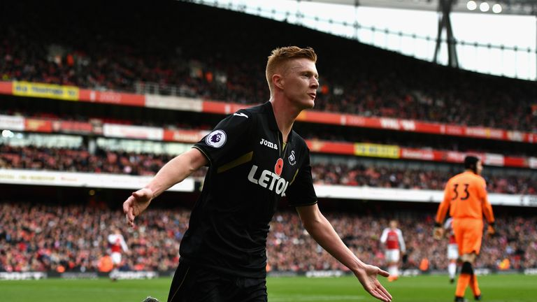 Clucas celebrates his goal for Swansea against Arsenal in October 2017