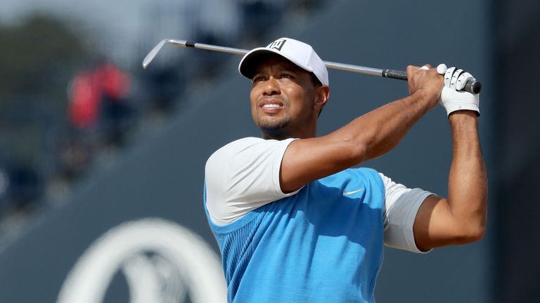 Tiger Woods plays his second shot on the first hole during the 147th Open Championship at Carnoustie Golf Links on July 19, 2018