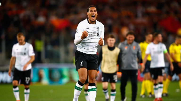 Virgil van Dijk of Liverpool celebrates after the full time whistle as Liverpool qualify for the Champions League Final during the UEFA Champions League Semi Final Second Leg match between A.S. Roma and Liverpool at Stadio Olimpico on May 2, 2018 in Rome, Italy.