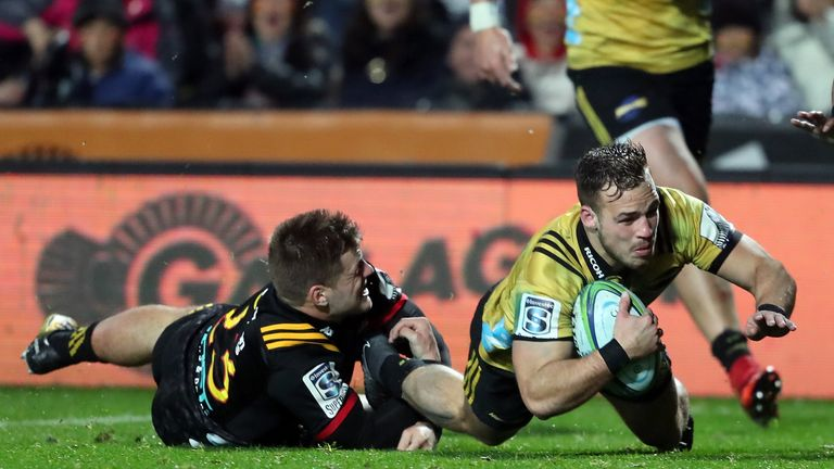 Hurricanes' Wes Goosen dives over for a try against the Chiefs