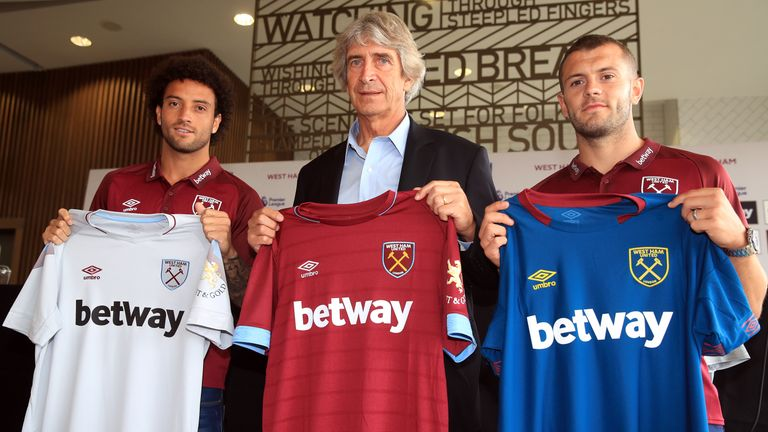 West Ham manager Manuel Pellegrini (centre) with Felipe Anderson (left) and Jack Wilshere during a press conference at the London Stadium, London