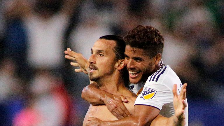 Zlatan Ibrahimovic and Jonathan Dos Santos #8 of the Los Angeles Galaxy celebrate the Swede's hat-trick