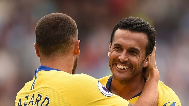 Pedro celebrates with Chelsea teammate Eden Hazard after making it 3-0