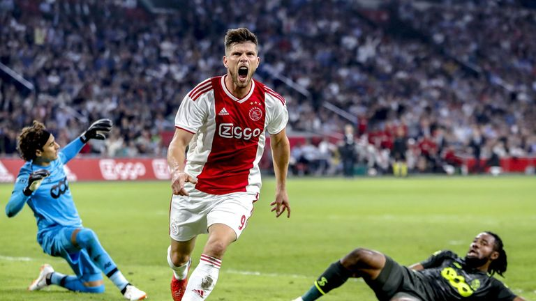 Ajax's forward Klaas Jan Huntelaar (C) celebrates his 1-0 goal against Standard Liege