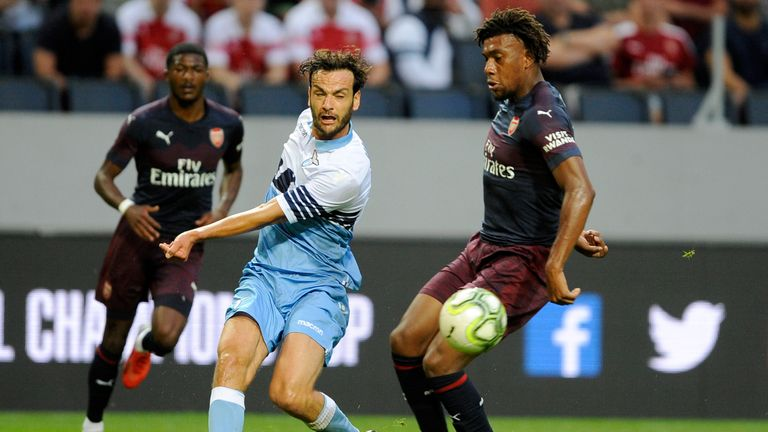 Alex Iwobi (R) battles for the ball with Marco Parolo