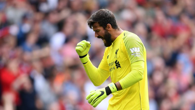 Alisson celebrates Liverpool's first goal