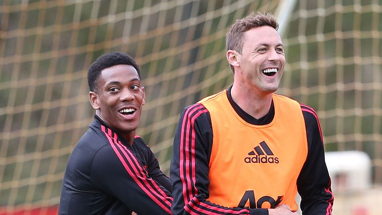 Anthony Martial and Nemanja Matic share a joke in training