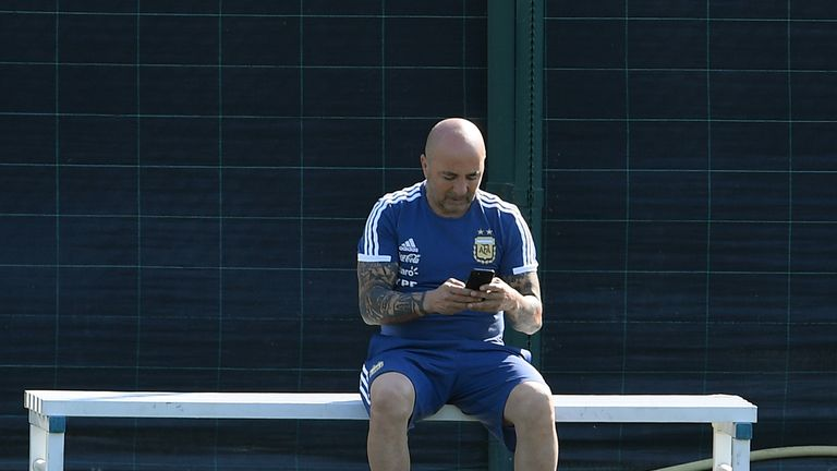 Jorge Sampaoli Argentina manager using mobile phone on touchline at training