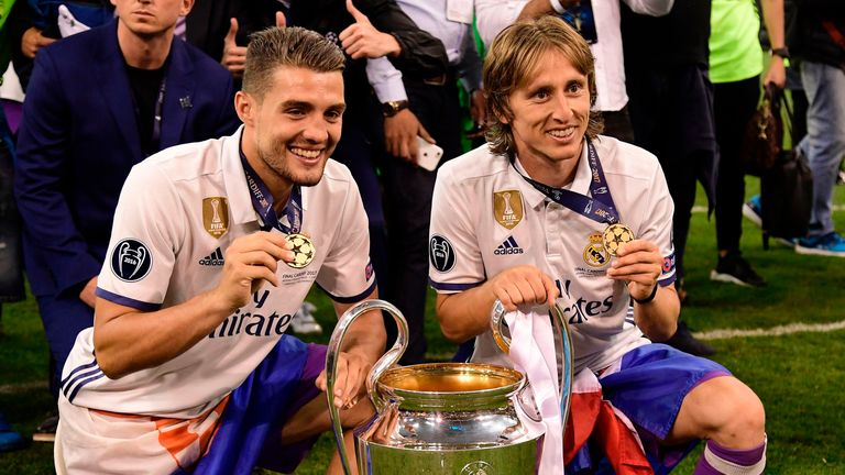 Mateo Kovacic and Luka Modric celebrate with the Champions League trophy in 2017