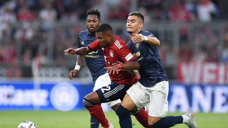 Manchester United's Brazilian Fred, Bayern Munich midfielder Serge Gnabry and United midfielder Andreas Pereira vie for the ball during the pre-season friendly football match between FC Bayern Munich and Manchester United at the Allianz Arena in Munich, southern Germany on August 5, 2018