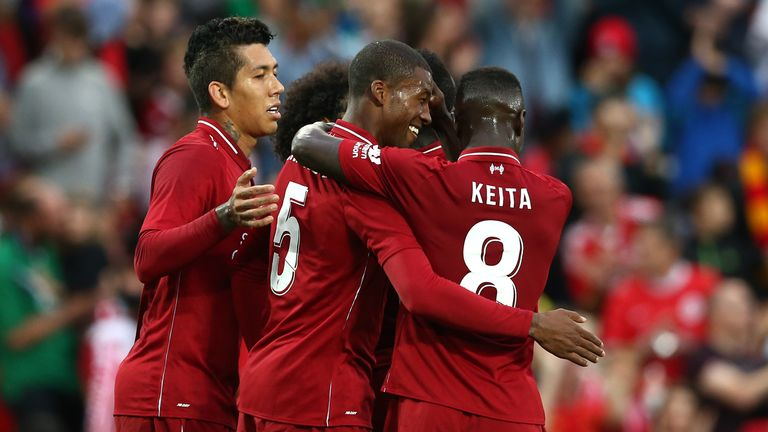 Georginio Wijnaldum of Liverpool celebrates his goal with team-mates during the pre-season friendly match between Liverpool and Torino at Anfield on August 7, 2018 in Liverpool, England
