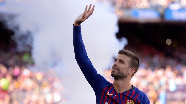 Barcelona's Spanish defender Gerard Pique waves at fans before the 53rd Joan Gamper Trophy friendly football match between Barcelona and Boca Juniors at the Camp Nou stadium in Barcelona on August 15, 2018.