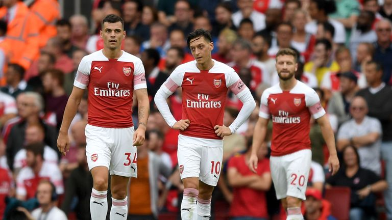 Arsenal's Granit Xhaka, Mesut Ozil and Shkodran Mustafi during the 2-0 home defeat to Manchester City
