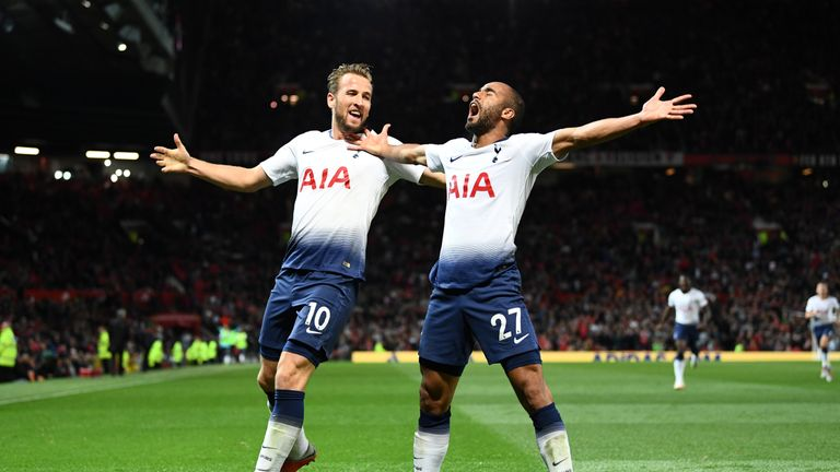 Harry Kane and Lucas Moura during the Premier League match between Manchester United and Tottenham Hotspur at Old Trafford on August 27, 2018 in Manchester, United Kingdom