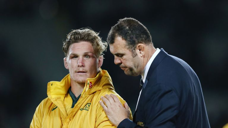 Australia skipper Michael Hooper and head coach Michael Cheika look on after the defeat