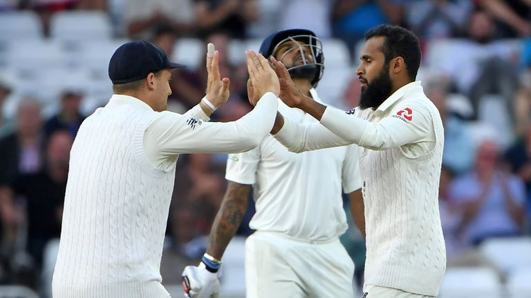 Adil Rashid has Shikhar Dhawan stumped but England were second best on day two