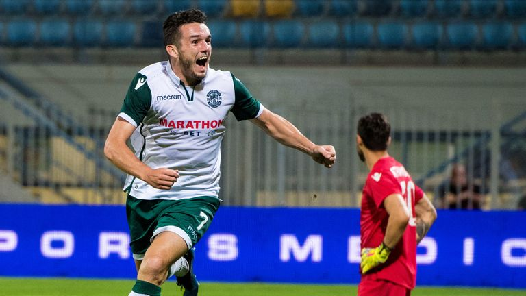 John McGinn wheels away after firing Hibs into the lead against Asteras Tripolis