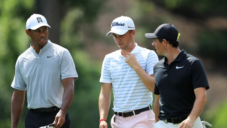 Woods, Thomas and McIlroy still have 11 holes to complete