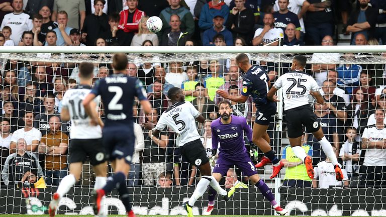 Roofe heads in the first of two goals as Leeds beat Derby at Pride Park