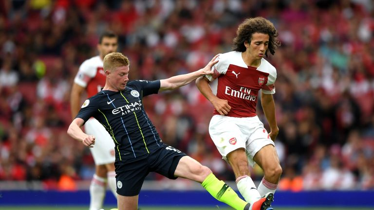 Kevin De Bruyne puts in a challenge on Matteo Guendouzi at the Emirates Stadium on Sunday