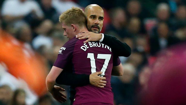 Manchester City manager Pep Guardiola embraces Kevin de Bruyne