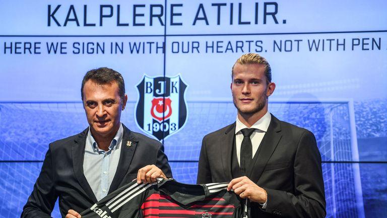Loris Karius poses alongside Besiktas President Fikret Orman during his unveiling at Besiktas