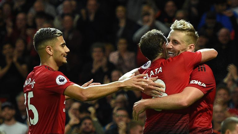 Luke Shaw celebrates his goal with teammates