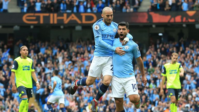Aguero celebrates with David Silva in the first half