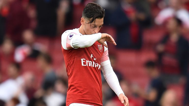 Mesut Ozil looks dejected after Arsenal's defeat to Manchester City